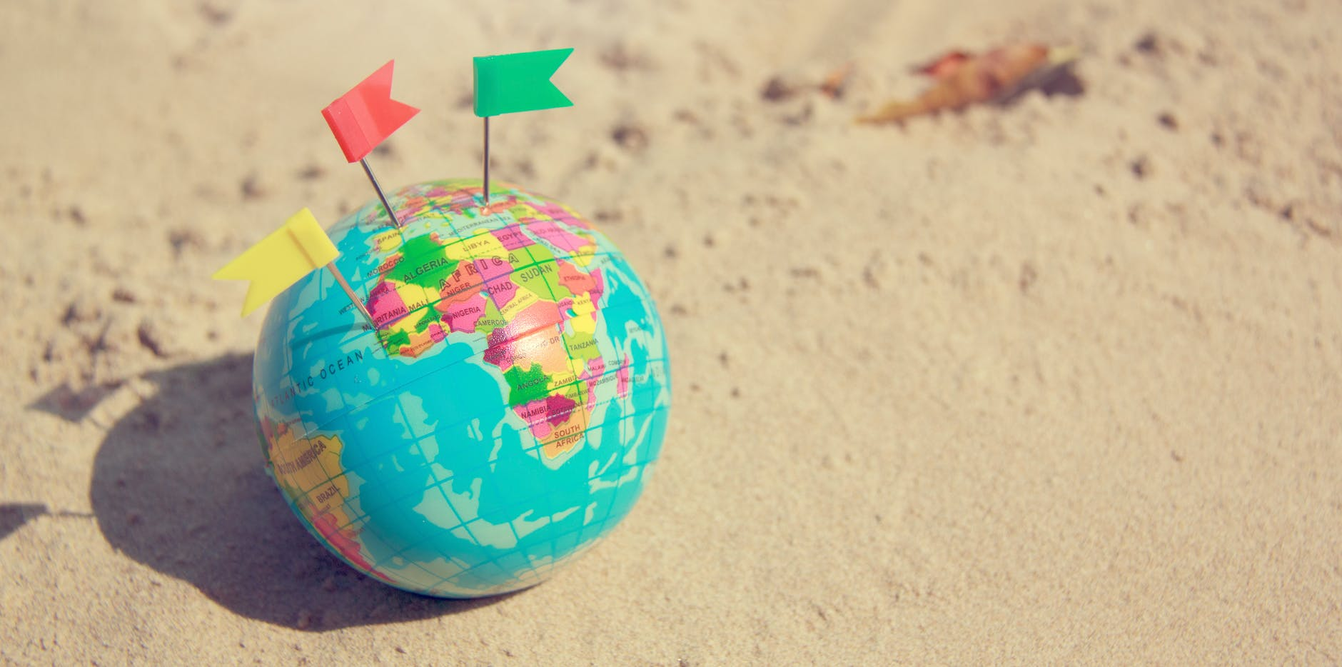 globe on sand